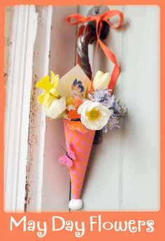 I remember hanging May Baskets on neighbor's doors when I was little.  Did you?