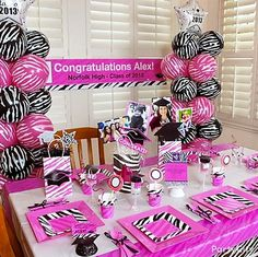 Pink and zebra graduation party theme! Click for ideas including cute DIY photo centerpieces.