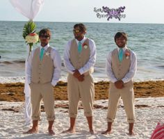 Beach Themed Wedding Groomsmen Khaki Vest with Matching Turquoise Blue Tied Sand Dollar Coral Floral for the Groomsmen Starfish and Sand Dollar for the Groom No Shoes No Problem!! Sarandipity Photography www.sister-secrets.com