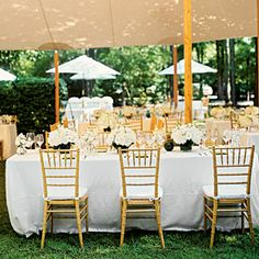 Reception Brunch - the white umbrellas and tables used in addition to the tables under tent; relaxed yet classic