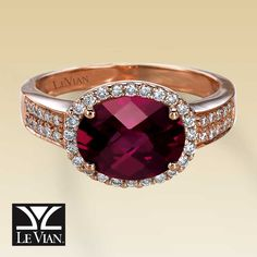 An eye-catching Raspberry Rhodolite garnet is the alluring focal point of this dramatic ring for her. Dazzling round diamonds surround the centerpiece and dance along the 14K Strawberry Gold