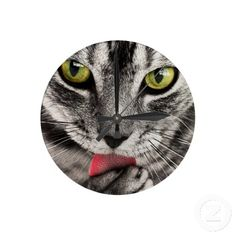 Wall clock with cute closeup picture of a tabby cat licking its paw.