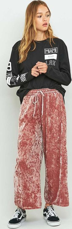 Light Before Dark Crushed Velvet Culottes. Minimalist with a twist culottes are brought to you by UO's very own Scandi inspired label, Light Before Dark. Ultra soft crushed velvet constructed with a high rise elasticised drawstring waist. Finished with a slightly cropped length and slit side entry pockets #LightBeforeDark #Pink #Culottes #UrbanOutfitters #Women #fashion #obsessory #cozy #chic #fashion #lifestyle #style #myobsession