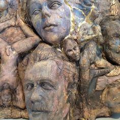 This piece is a personal favorite. A dense sculpture group of figures and faces in varying sizes, each figure is rich with a fascinating texture and earthy color. It explores an idea of a weathered surface, each figure appears to have endured many things. Its as if an enveloping veil is beginning to pull apart to see the depth of their humanity.  It is 22 inches tall by 24 inches wide by 7 inches deep. It is designed to hang on the wall on a french cleat, or stand freely on a flat surface…