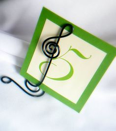 Black Treble Clef Table Number Stands, Music Theme Weddings. $12.00, via Etsy.