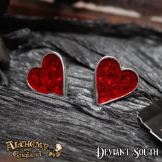 Alchemy Gothic Heart's E332 Blood Stud Earrings (pair)  A pair of clear red enamelled pewter heart studs with Swarovski crystals set just beneath the surface.