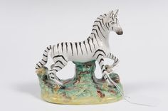 Victorian Staffordshire zebra figure on naturalistic floral base, 12.5cm high