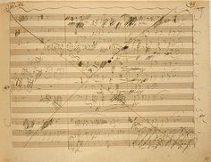 A heavily scored out and amended page from Beethoven's 6th Symphony - original hand-written manuscript.