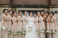 Bridesmaids in champagne dresses | Bride wearing Legends Romona Keveza gown and lace jacket, Ivy and Aster sash, and Christos Bridal veil, all from Something White, A Bridal Boutique, Independence, Ohio | photo by The Carrs Photography