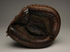Catcher's mitt used by Yogi Berra catching a perfect game in the 1956 World Series - B-128.58  (Milo Stewart Jr./National Baseball Hall of Fame Library)