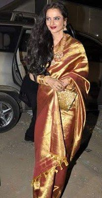 Rekha looked Gorgeous in golden colour Silk Saree at the star screen awards function.