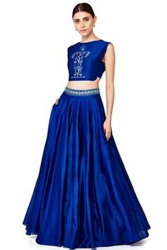 Featuring an ink blue chanderi silk crop top with resham embroidered floral motif in the front. It has asymmetrical side panels and cut out detailing at the back. It comes along with a matching chanderi silk lehenga with gota patti and resham work beltby ANITA DONGRE Shop now-www.carmaonlineshop.com  #carma #carmaonlineshop #style #fashion #designer #indianfashion #indiandesigner #ANITA DONGRE #gown #couture #shopnow #indianwear #pretty #girly #onlineshopping #instashop #beautiful…
