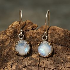 Moonstone drop earrings in silver bezel setting with polished brass accent prongs