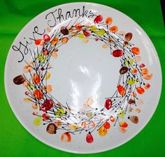 This would be WONDERFUL for those with children, godchildren, grands, etc! Their little thumbprints as Thanksgiving leaves! Thanksgiving Plates, Thanksgiving Preschool, Thanksgiving Turkey, Thanksgiving Decorations, Fingerprint Crafts, Footprint Crafts, Pottery Painting, Ceramic Painting, Painted Pottery