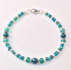 Teal & Silver Beaded Bracelet, Glass Czech Seed Beads Braclet, blue green Stacking Friendship, Fashionista Jewelry Wrist Choose Your Size by EverydayWomenJewelry on Etsy https://www.etsy.com/listing/228511523/teal-silver-beaded-bracelet-glass-czech