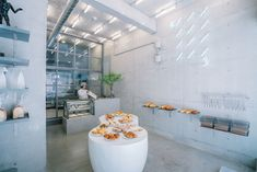 fathom designs japanese bakery ripi as a continuous space of concrete + glass Cake Shop Design, Coffee Shop Design, Bakery Design, Bakery Interior, Cafe Interior Design, Cafe Design, Design Design, Japanese Coffee Shop, Japanese Bakery