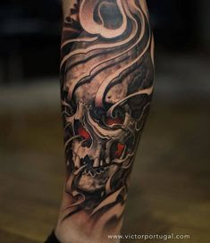 Black and grey skull tattoo on the right calf. Tattoo Artist: Victor Portugal