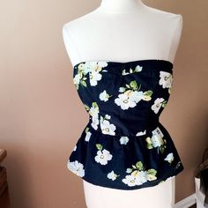 Hollister strapless top Navy blue floral strapless top from Hollister. Probably junior size. Pinned on size 6/8 mannequin (37-26-37)Check out the $6 section near the bottom of my closet (before the sold items) for lots of bundle-worthy $6 items! 15% bundle discount on 2+ items in a bundle. Hollister Tops