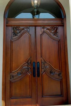 Custom hand carved entry doors