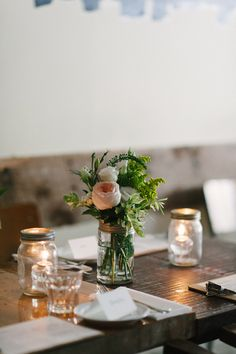 simple centerpieces, adds a delicate touch!  Katie & Markus' intimate wedding - Celine Kim Photography