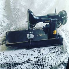 Very excited to be listing this beauty shortly! Vintage Singer Featherweight  fully functional WITH extra feet peddle caring case AND a bonus button holer! Such a beauty and she purrs like a kitten!  Keep your eyes out for a video of it in use and the listing!  #vintage #singer #sewing #vintagesewing #VintageShop #vintagesewingmachine #singersewing #etsyfinds #etsyshop #etsyvintageshop #etsy
