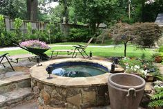 Rustic Hot Tub with exterior stone floors, Pathway, Fence, Raised beds