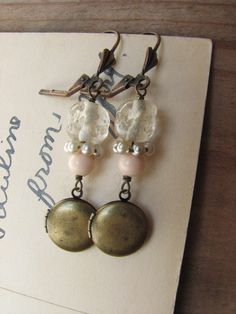 Hey, I found this really awesome Etsy listing at https://www.etsy.com/listing/177044932/shabby-chic-assemblage-locket-earrings