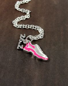 Next on my list... Marathon Running Shoe Necklace Silver Plated by treasuredcharms, $12.00