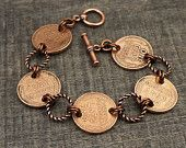 This bracelet measures 7 1/4 long (18.5cm) and features a little slice of history--several wheatie pennies linked together with textured copper jump rings.  The penny links are real coins with two holes drilled in it, most of them dating from the forties. The clasp is made from copper-plated leadfree pewter. The jump rings are made of textured copper and enameled copper.   ----------------------------  Thank you for browsing my shop!  If youd like to see my necklaces and jewelry sets, click…