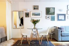 Sarah used a beautiful antique rug to separate the dining area from the living area.