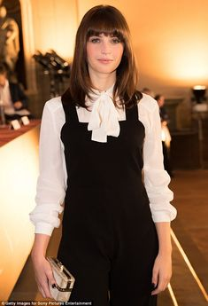 Style queen: Felicity Jones, 32,ditched the floor-length gown for a trendy jumpsuit and blouse combo on Thursday as she attended the photo call for her new film Inferno in Florence, Italy