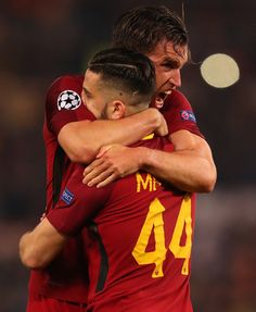 Kevin Strootman of AS Roma and Kostas Manolas of AS Roma celebrate at the full time whistle during the UEFA Champions League Quarter Final Second Leg match between AS Roma and FC Barcelona at Stadio Olimpico on April 10, 2018 in Rome, Italy.