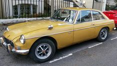 My 1972 Harvest Gold MGB GT. In need of much tlc.