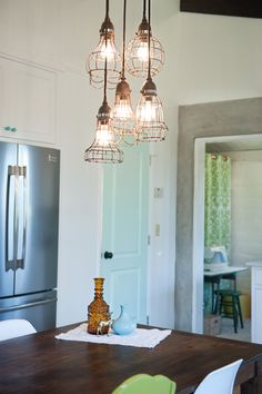 industrial cage light fixture - looks cool and gives you lots of light to work under. As seen on designsponge.