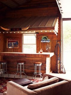 The rustic bar inside Hannah and Paul Catlett's home in Springfield, Missouri. Photo by: Joe Pugliese | Read more: http://www.dwell.com/articles/A-Little-Bit-Country.html.