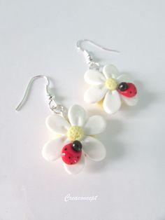 Boucles d'oreilles marguerites et coccinelles en porcelaine froide http://www.alittlemarket.com/boutique/creaconcept-899765.html#search_tri