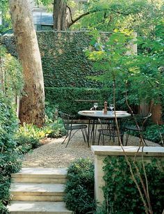 I want a little nook like this outside.  The trees and greenery make it peaceful.  It'd be a great spot to sit back and relax, or to brainstorm new ideas for stories and artwork.