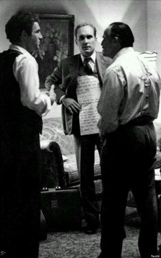 Wow! Marlon Brando reading off cue cards held up by co-star Robert Duvall. Behind the scenes of The Godfather