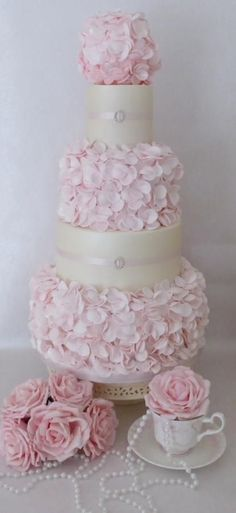 Pretty pink ruffle wedding cake ~ all sugar roses as well ~ all edible. ᘡղbᘡ by melinda