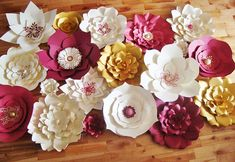 Let us create a beautiful Paper Flower Backdrop to enhance the decor for your wedding, event, or home. We design, make and send you the flowers and you use them to create a dream flower wall for your home, baby nursery, wedding, event, etc. Flowers come completed (no assembly