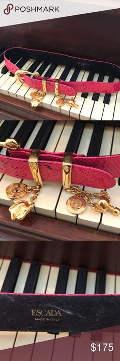 Escada Belt Rare collectors itemSz 36 Sz small-Med Escada Belt Rare collectors item. Authentic. Sz 36. Small fit. Hot pink. Gold charms dangles elegantly with motifs of horse, EE, winners cup, horse bridle. One of a kind belt. Leather snake print. Like new. Escada Accessories Belts