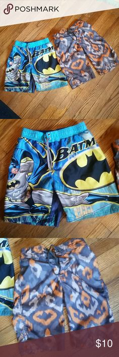 2 boy's swim trunks Gymboree and Batman Excellent used condition, only worn a couple of times last summer and this summer they don't fit anymore! The Batman shorts are size 6/7 and the Gymboree ones are a size 7. They fit similarly. Gymboree Swim