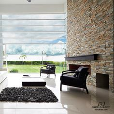 This faux stone wall is a floor to ceiling masterpiece!  #stunning #fauxstone