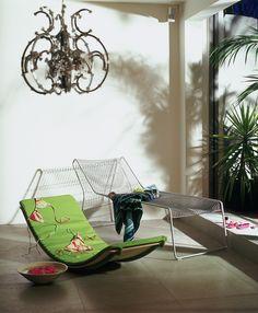 Slim and sleek modern sun loungers are a must for any design lovers garden. Image : Livingetc  Livingetc