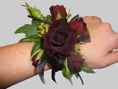 "succulent corsage | Wrist Corsage of ""black beauty"" spray roses, green berzelea berries ..."
