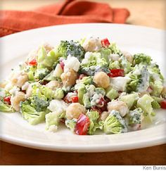 This #salad #recipe features chopped broccoli tossed in a low-fat yogurt & feta dressing