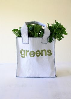 COOL. She fused plastic grocery bags together to create the fabric for this reusable bag. #recycle