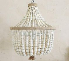 Lighting - Wood beads in soft, natural hues bring warmth and simplicity to the room. The beads are graduated in size and color for added visual interest.<br />