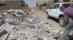 Iraq: US Christian Amish volunteers restore houses damaged by conflict w...