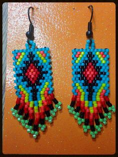 Mimics the colors of the southwest sunset. Made with Delica beads and black hooks with rubber stoppers. Beaded Earrings Native, Beaded Earrings Patterns, Seed Bead Patterns, Beading Patterns, Beading Ideas, Fringe Earrings, Star Earrings, Seed Bead Jewelry, Seed Bead Earrings